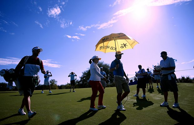 Inbee Park leaves No. 9 during the pro-am with her fiance and coach, Gihyeob Nam at the CME Group Titleholders at Tiburon Golf Club in Naples, Fla.