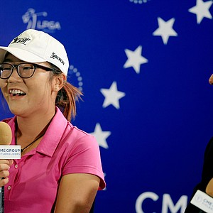 Lydia Ko addresses the media in her first official LPGA press conference as a professional during the CME Group Titleholders at Tiburon Golf Club in Naples, Fla. At right is Kraig Kann, chief communications officer for LPGA.