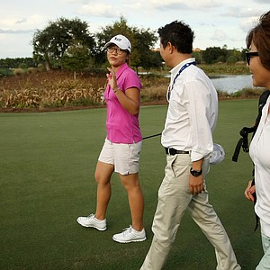 Lydia Ko leaves the putting area with her mom, far right, Tina, on the eve of the CME Group Titleholders at Tiburon Golf Club in Naples, Fla.
