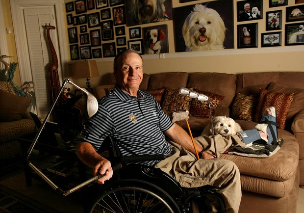 Dennis Walters and his dog Bucky at his home in Jupiter, Fla.