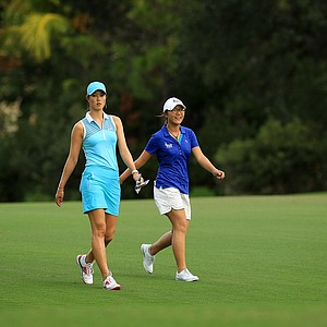 Michelle Wie and Lydia Ko walk together during their round at the CME Group Titleholders at Tiburon Golf Club in Naples, Fla.