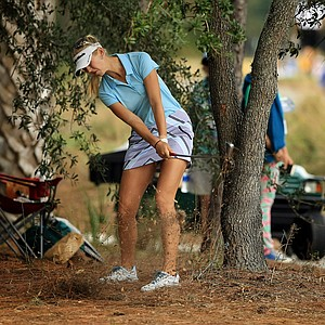 Jessica Korda hits from the trees at No. 6 during the first round of the CME Group Titleholders at Tiburon Golf Club in Naples, Fla.