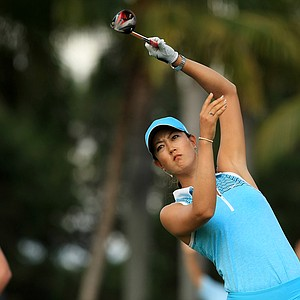 Michelle Wie lets go of her club after hitting a tee shot at No. 9 during the first round of the CME Group Titleholders at Tiburon Golf Club in Naples, Fla.