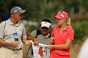 Anna Nordqvist signs autographs after posting a 66 on Wednesday at the CME Group Titleholders at Tiburon Golf Club in Naples, Fla.