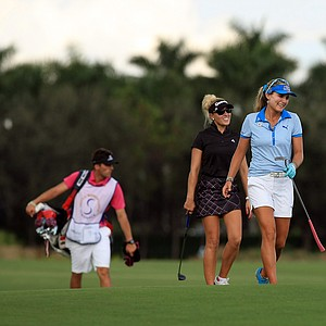 Lexi Thompson and Natalie Gulbis walk up No. 18 at the CME Group Titleholders at Tiburon Golf Club in Naples, Fla.