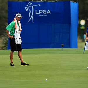 Lydia Ko and her caddie Micky Millburn watch her putt at No. 18 during the opening round of the CME Group Titleholders at Tiburon Golf Club in Naples, Fla.