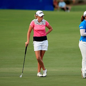 Stacy Lewis and Inbee Park wait to putt at No. 18 during the opening round of the CME Group Titleholders at Tiburon Golf Club in Naples, Fla.