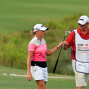 Stacy Lewis shares a fist bump with her caddie Travis Wilson during the opening round of the CME Group Titleholders at Tiburon Golf Club in Naples, Fla.