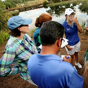 Lydia Ko, center, is surrounded my media after her first round as a professional at the CME Group Titleholders at Tiburon Golf Club in Naples, Fla.