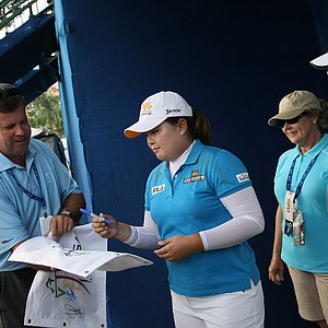 Inbee Park signs autographs after her first round at the CME Group Titleholders at Tiburon Golf Club in Naples, Fla.