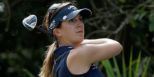 Gal builds 3-shot lead in wind at Titleholders