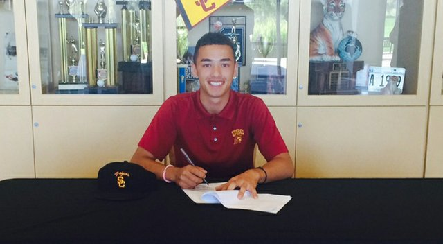 Jonah Texeira, shown here signing with USC during the early signing period, shot 5-under 67 to grab the first-round lead at the Polo Golf Junior Classic.