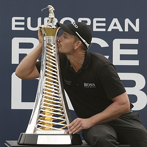 Henrik Stenson celebrates his 2013 Race to Dubai title on the European Tour after his DP World Tour Championship victory.