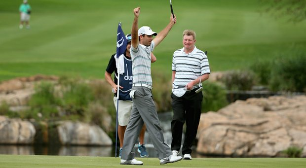 Charl Schwartzel celebrates after winning the Alfred Dunhill Championship.