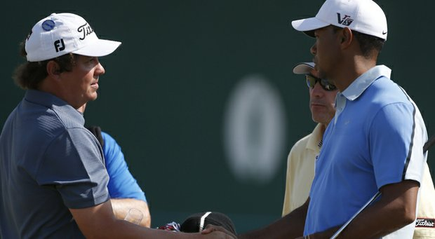 Jason Dufner and Tiger Woods shake hands during the 2013 Open Championship.