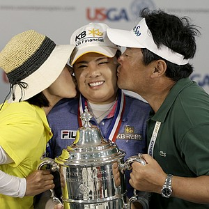 Inbee Park, of South Korea, center, won the U.S. Women's Open golf tournament at Sebonack Golf Club in Southampton, N.Y. on June 30, 2013. Earnings: $585,000