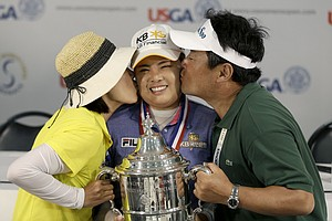 Inbee Park, of South Korea, center, won the U.S. Women's Open golf tournament at Sebonack Golf Club in Southampton, N.Y. on June 30, 2013. Earnings: $585,000