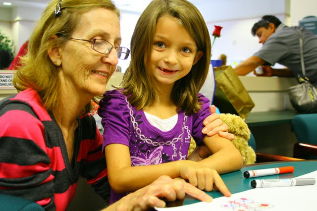"Riley Crites, 7, with adopted ""mom"" grandmother Judy Crites at the National Adoption Day event held in Orlando Nov. 22. Dozens of families were officially created at the event."