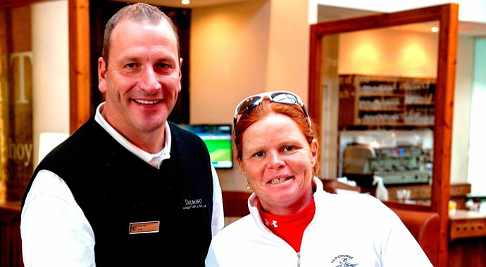 Heather Stirling, right, with Alan Tait, a Scottish golf professional and former European Tour player.