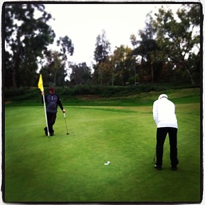 Andy Curtis of Cobra-Puma Golf makes a birdie at No. 16 during the Industry Cup at Oak Creek in Irvine, Calif.
