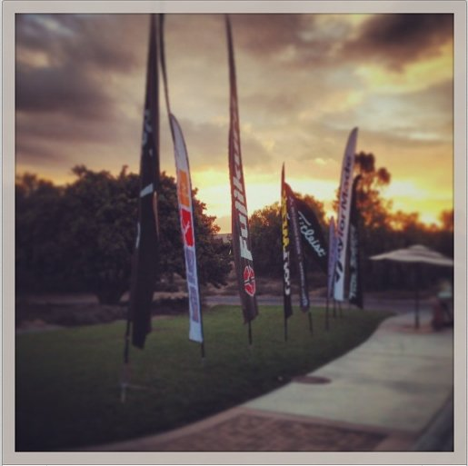 Flags were already blowing around at sunrise before the start of the Industry Cup at Oak Creek in Irvine, Calif.