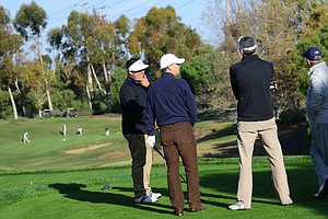 In a meeting of the minds, Harry Arnett and Tim Reed talk with Golfweek's Brandon de la Cruz and Jereme Day on the 11th tee during the final round of the Industry Cup at Oak Creek GC in Irvine, Calif.