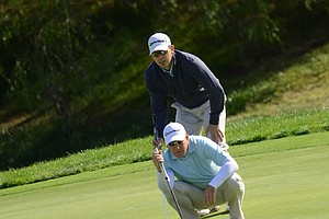 The Taylormade team of Greg Cesario and Frank Firman line up a putt on the fourth green during the final round of the Industry Cup at Oak Creek GC in Irvine, Calif.