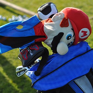An array of headcovers were on the range at Oak Creek GC, including Mario on top of a Titleist bag.