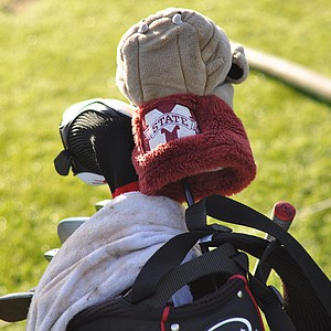A Mississippi State headcover sits atop the bag of Titleist's Austin Tudor before the second round at the Industry Cup in Irvine, Calif.