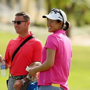 Instructor Sean Foley talks Yueer Cindy Feng at the end of LPGA Qschool final at LPGA International.