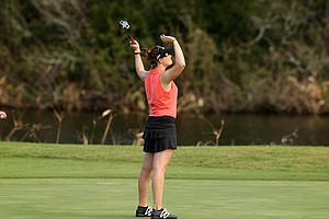 Victoria Elizabeth raises her hands in the air after finishing LPGA Qschool final at LPGA International.