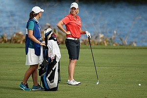 Reilley Rankin consults with her sister, Caroline, at No. 18 during LPGA Qschool final at LPGA International. Rankin missed securing her card by one stroke on Sunday.