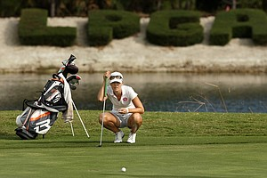 Megan  McChrystal looks over her putt at No. 18 during LPGA Qschool final at LPGA International.