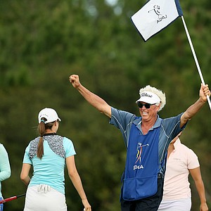 Donnie Green raises his hand in the air after he and his daughter, Jaye Marie Green, won LPGA Qschool final at LPGA International