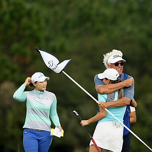 Jaye Marie Green gets a hug from her dad/caddie, Donnie Green, after she won LPGA Qschool final at LPGA International.