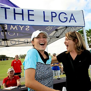 Jaye Marie Green celebrates winning LPGA Qschool by 10-shots during the final at LPGA International. At right is her mom, Stephanie.
