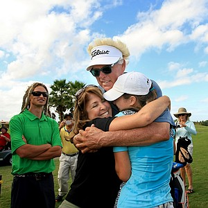Donnie Green who caddied for his daughter Jaye Marie Green, right, has a family hug with Jaye, and his wife Stephanie after Jaye Marie Green won LPGA Qschool final at LPGA International.