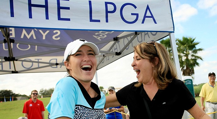 Jaye Marie Green and her mother, Stephanie, after besting the field by 10 shots at 2013 LPGA Q-School in Daytona Beach, Fla.