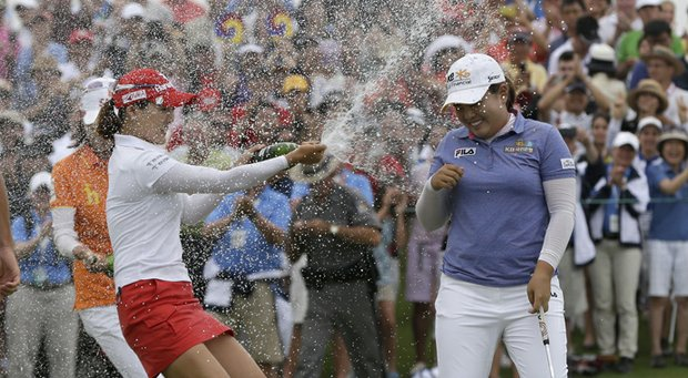 Inbee Park is met by So Yeon Ryu and a spray of champagne after wrapping up a win at the 2013 U.S. Women's Open.
