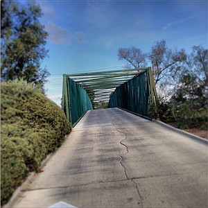 The path over railroad tracks that takes you to the 13th hole at Oak Creek GC in Irvine, Calif.