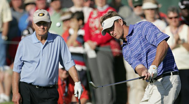 Jack Nicklaus II chips as his father watches during the Father/Son Challenge in 2008.