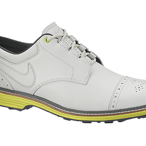 Nike's Lunar Clayton golf shoes shown in white and yellow.