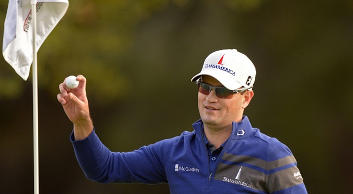 Zach Johnson holds up the ball he holed out with a wedge to force a playoff that he won over Tiger Woods in the 2013 Northwestern Mutual World Challenge.