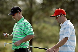 David Duval with his step-son Nick Karavites on Wednesday of the PNC Father/Son Challenge at The Ritz Carlton Golf Club of Orlando.