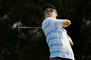 Nick Karavites, step-son of David Duval, watches his tee shot during Wednesday's practice round at the PNC Father/Son Challenge at The Ritz-Carlton Golf Club of Orlando.