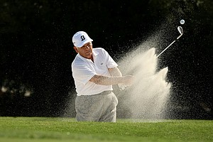 Lee Trevino practices his bunker shot on Wednesday at the PNC Father/Son Challenge at The Ritz Carlton Golf Club of Orlando.