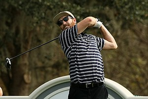 Shaun O'Meara hits his tee shot whle playing a practice round with his dad on Wednesday during the PNC Father/Son Challenge at The Ritz Carlton Golf Club of Orlando.
