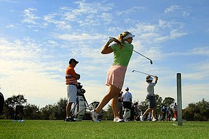 Christina Langer on the range with her father, Bernhard Langer, on Wednesday of the PNC Father/Son Challenge at The Ritz Carlton Golf Club of Orlando.