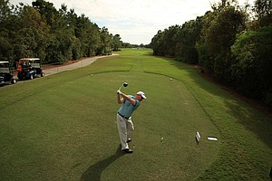 Josh Nelson, son of Larry Nelson, hits his tee shot at No. 1 on Wednesday of the PNC Father/Son Challenge at The Ritz Carlton Golf Club of Orlando.