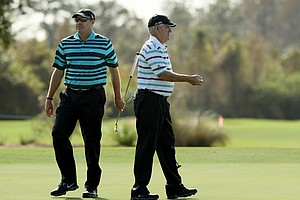 Dave Stockton, right, and his son, Dave Stockton Jr., during their practice round on Wednesday of the PNC Father/Son Challenge at The Ritz-Carlton Golf Club of Orlando.